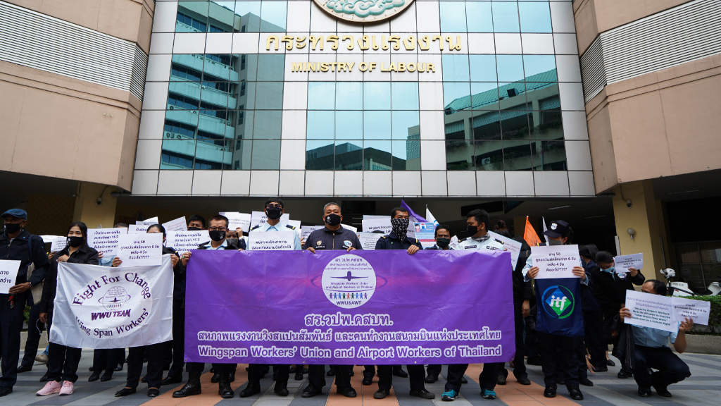 Bangkok airport workers protest attack on rights